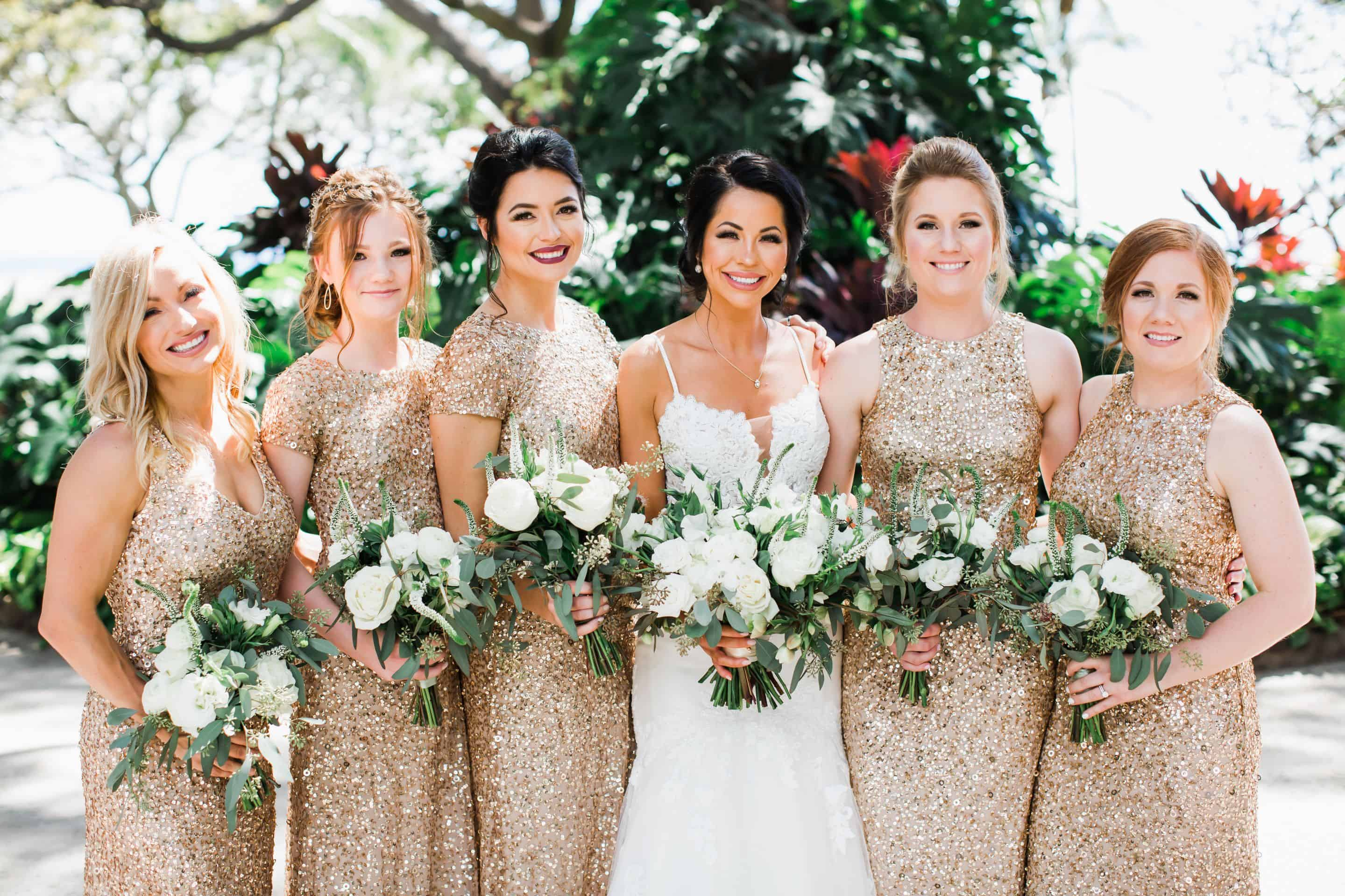Bridesmaids in gold sparkly dresses with white bouquets | Maui's Angels