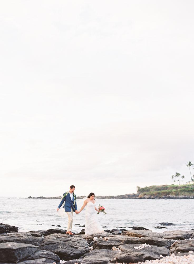 Couple walks along the oceanside