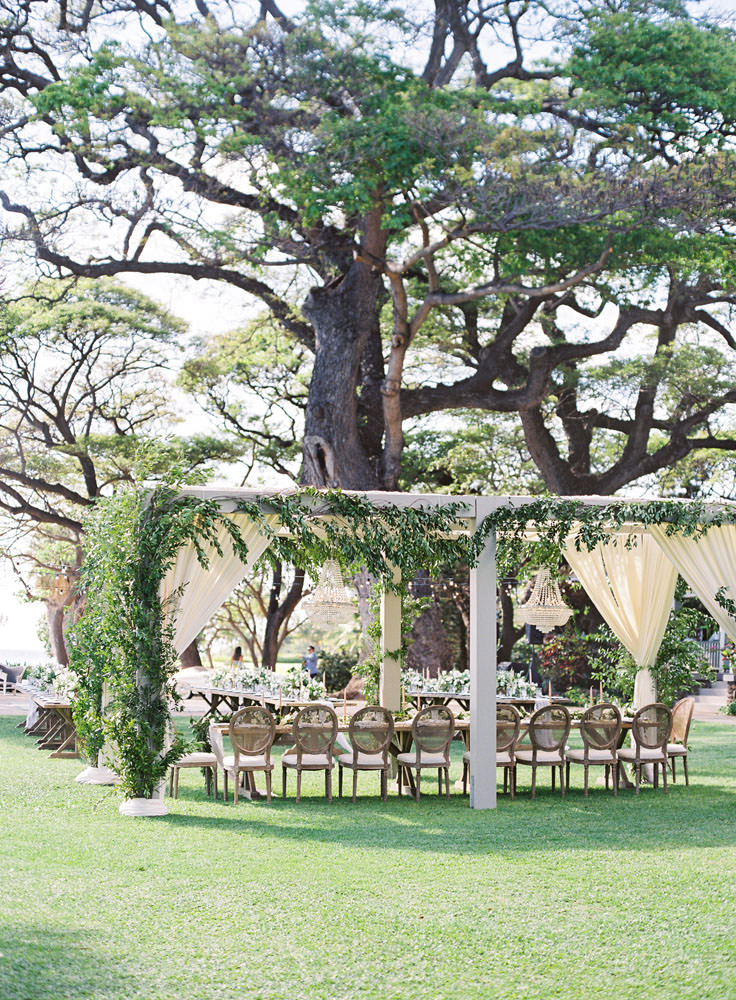 Plantation wedding chairs under a canopy